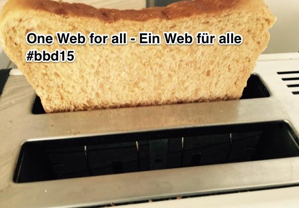 """Toaster mit ausgeworfenem Toast. Aufschrift """"One Web for all - Ein Web für alle #bbd15"""""""